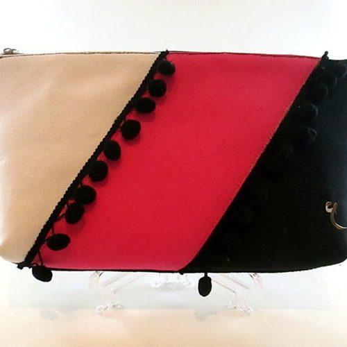 White pink black clutch
