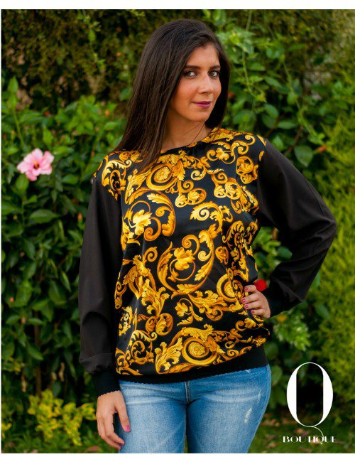A GOLDEN PRINT ON A SATIN BLOUSE